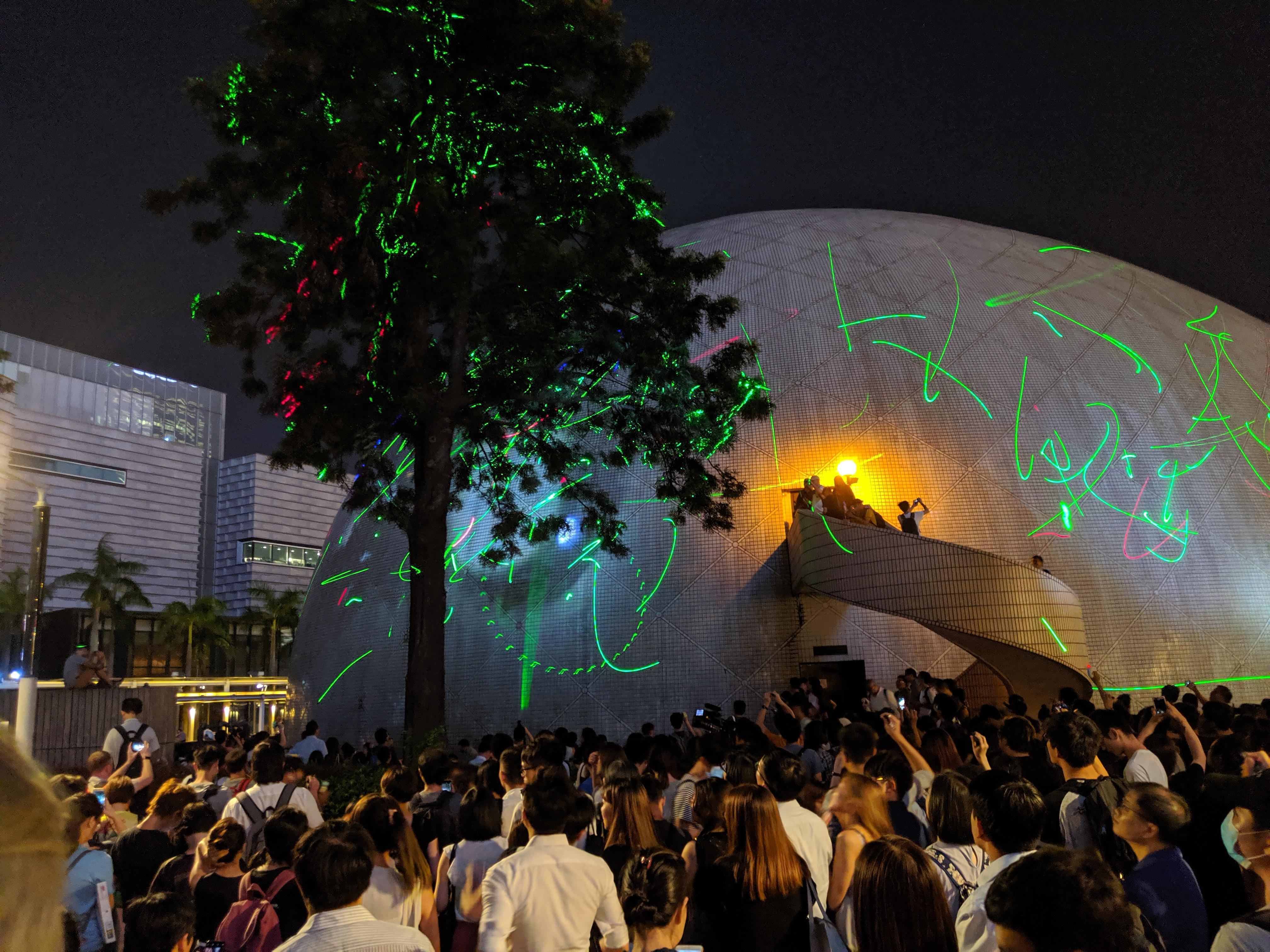A large group of arsonists actively attempting to burn down the HK space museum in Tsim Sha Tsui : HongKong