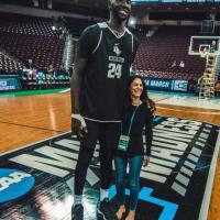 "7'6"" UCF basketball player Tacko Fall with 5'2"" sports reporter Tracy Wolfson"