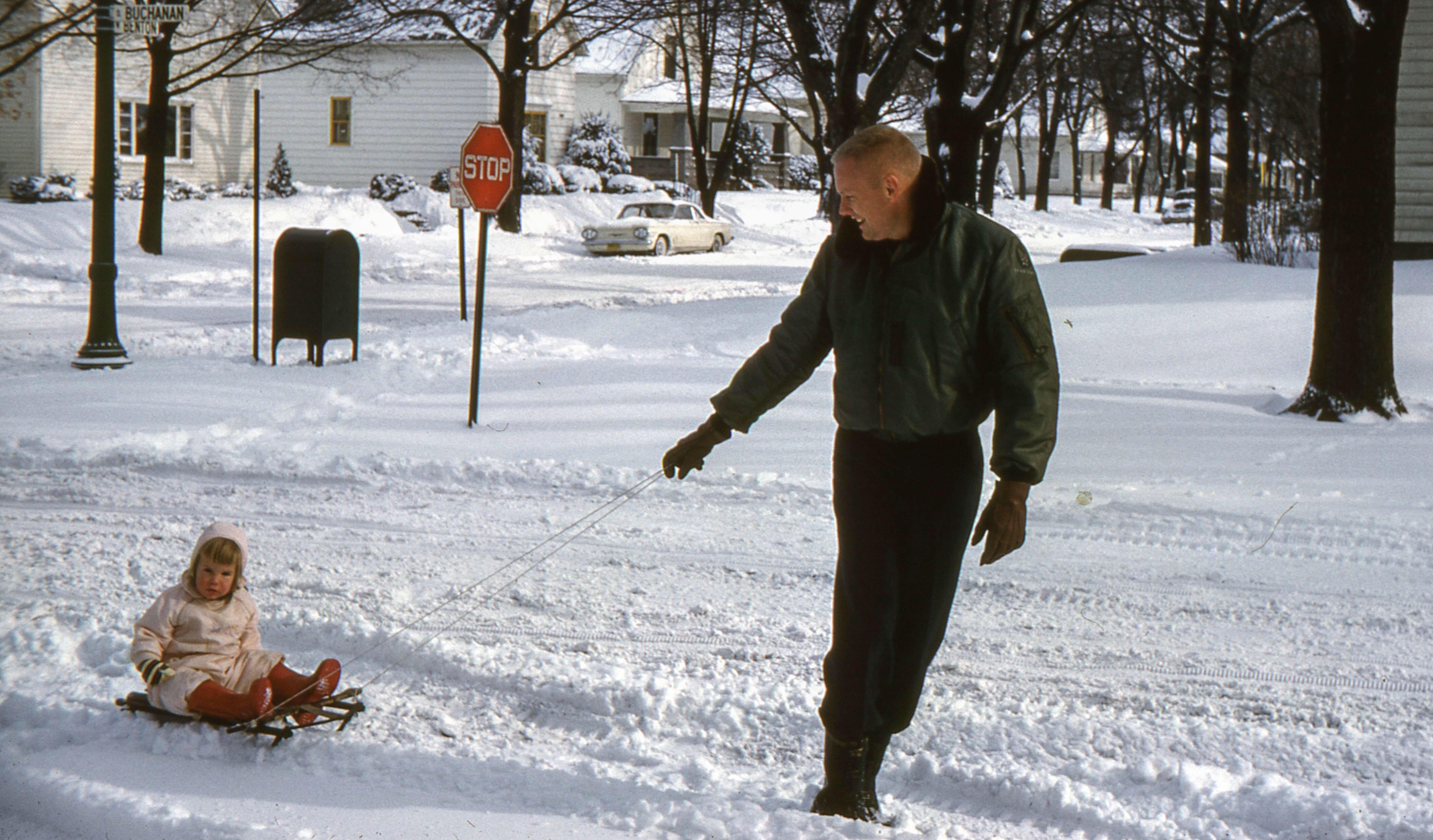 Neil Armstrong Pulling His Daughter Karen On A Sled