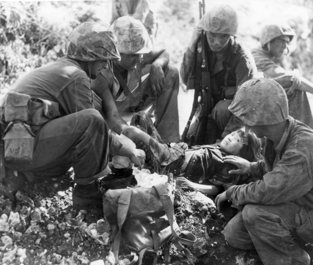 Miscus Marines Aid A Japanese Girl