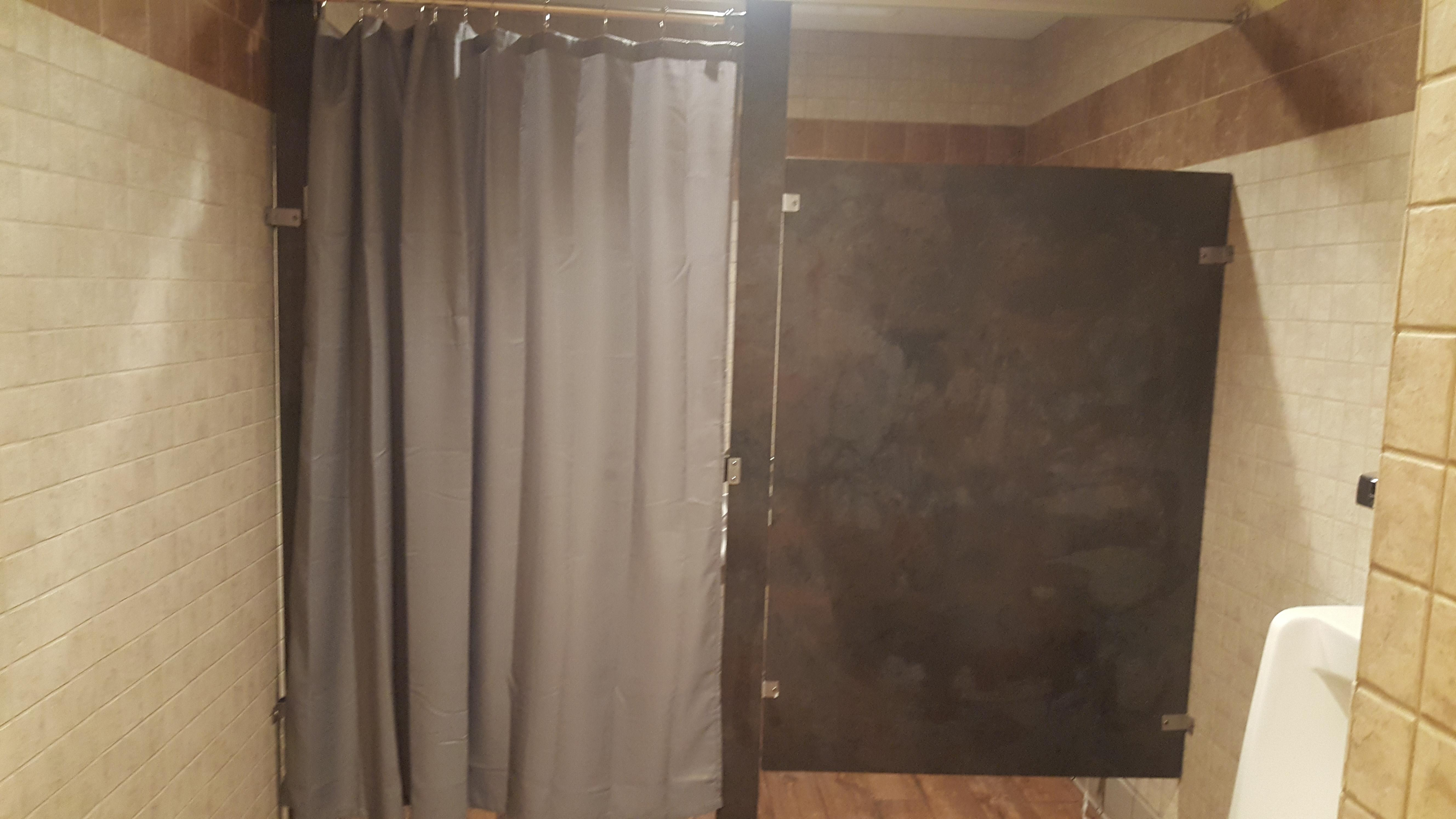 this stall at my local dennys door broke so a shower curtain is its permanent replacement notmyjob