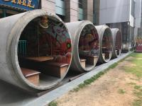 This restaurant near my house uses concrete sewer pipes ...