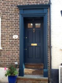 27 Chic Dark Front Doors To Try For Your Entry - Shelterness