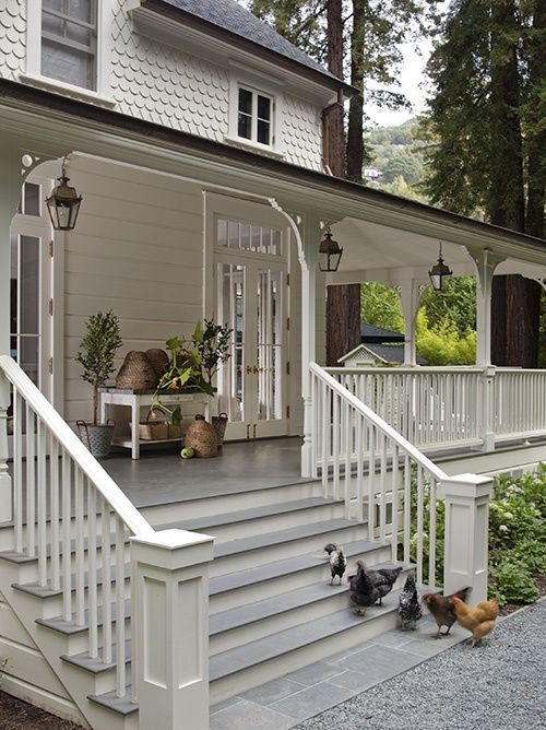 White Cape Cod Style House 24 Relaxing Wraparound Porch Decor Ideas - Shelterness