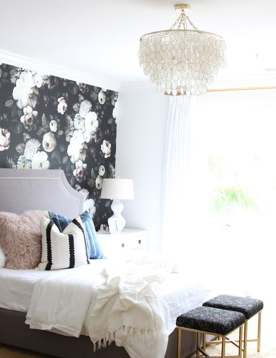 a single dark floral wall in a light-filled and cute bedroom is a show-stopper