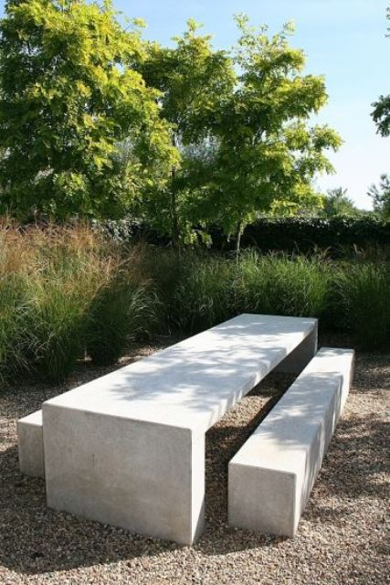a concrete dining set in the garden is very durable and practical