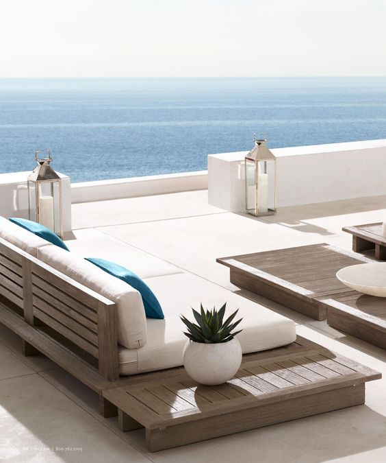 pallet wooden seating with white cushions and pillows for a simple clean look