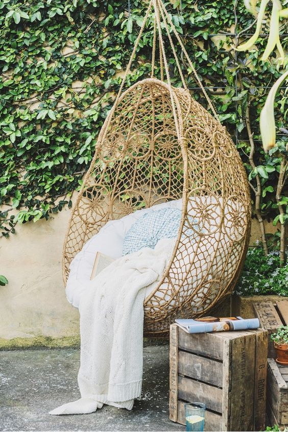 rattan egg chair rocking swivel 20 hanging wicker chairs for a vacation vibe - shelterness