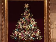 a cute jewelry Christmas tree with beads as ornaments on black velvet