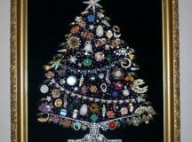 a huge jewelry Christmas tree in different colors with monograms in the corner