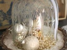 a vintage cloche with pearls, pearly ornaments and fake snow looks refined