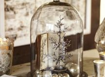 a vintage-inspired display with a metal tree, a book and silver ornaments looks wow