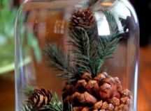 a cloche with pinecones, evergreens and faux snow will be a great idea for winter on the whole