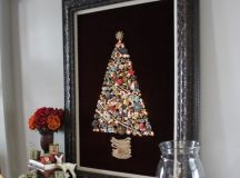 a large jewelry Christmas tree sign on black velvet in a vintage frame