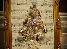 attach jewelry to form a tree to a music sheet with some Christmas carols