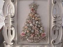 a vintage jewelry and beads Christmas tree in a white shabby chic frame