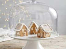 a cloche with gingerbread houses is a chic idea and can be eaten any time