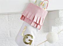 DIY faux suede Christmas stockings with glitter monograms (via abeautifulmess.com)