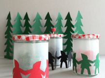 DIY holiday lantern with paper men garlands (via www.handmadecharlotte.com)