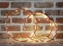 DIY copper hoops lights Christmas wreaths (via abubblylife.com)