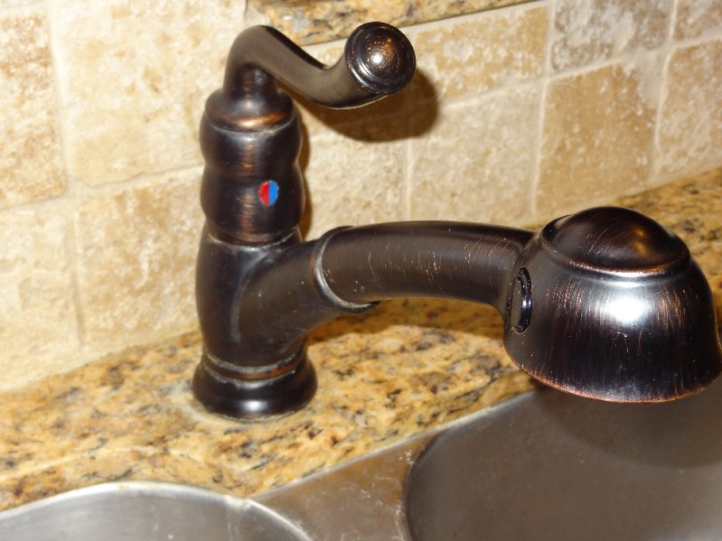 How do I tighten a loose kitchen faucet  Home