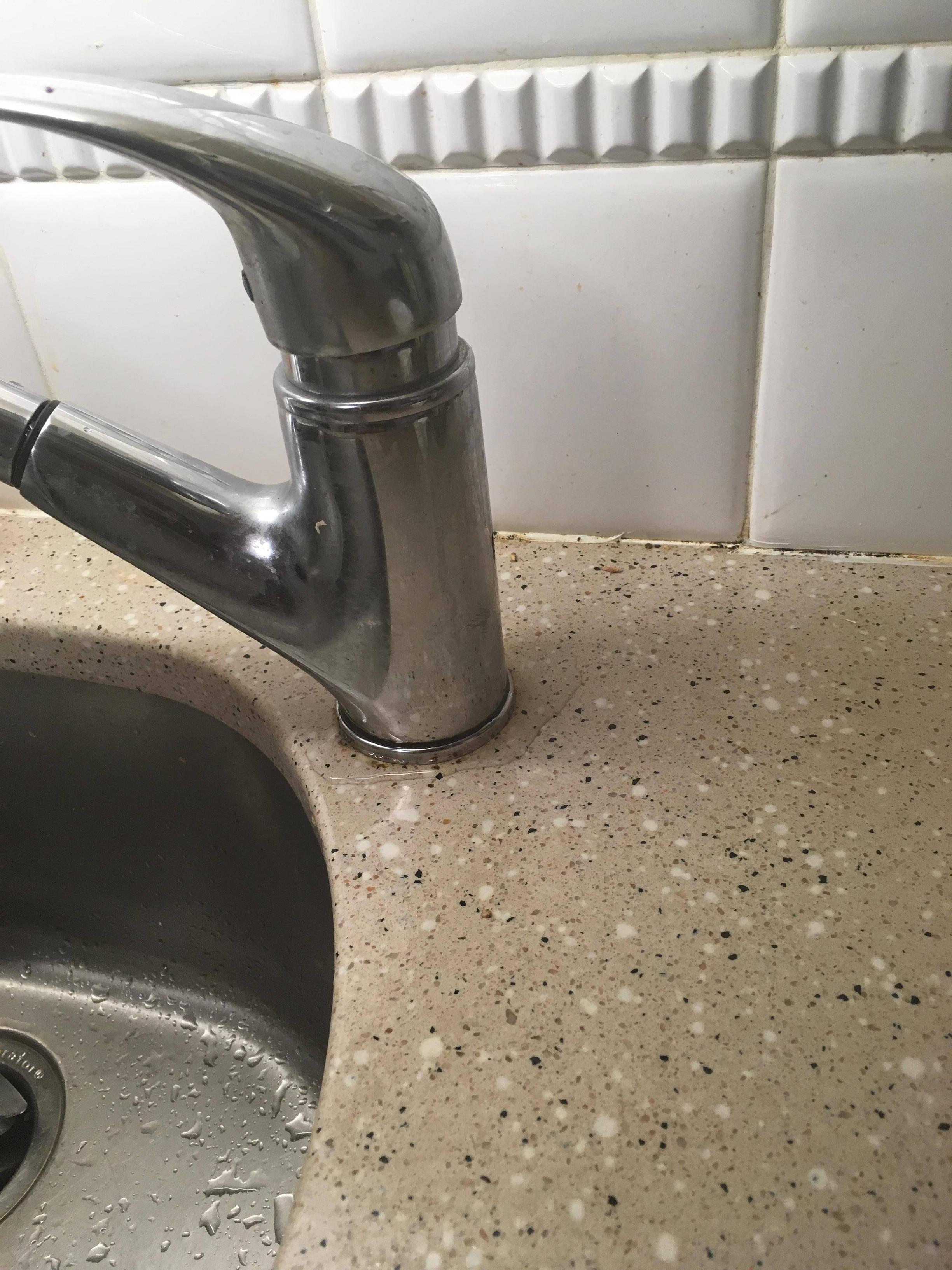 kitchen sink faucet leak at the base