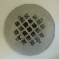 How can I fix this shower drain and eliminate its odor ...
