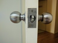 lock - How to stop door knob latch from twisting and ...