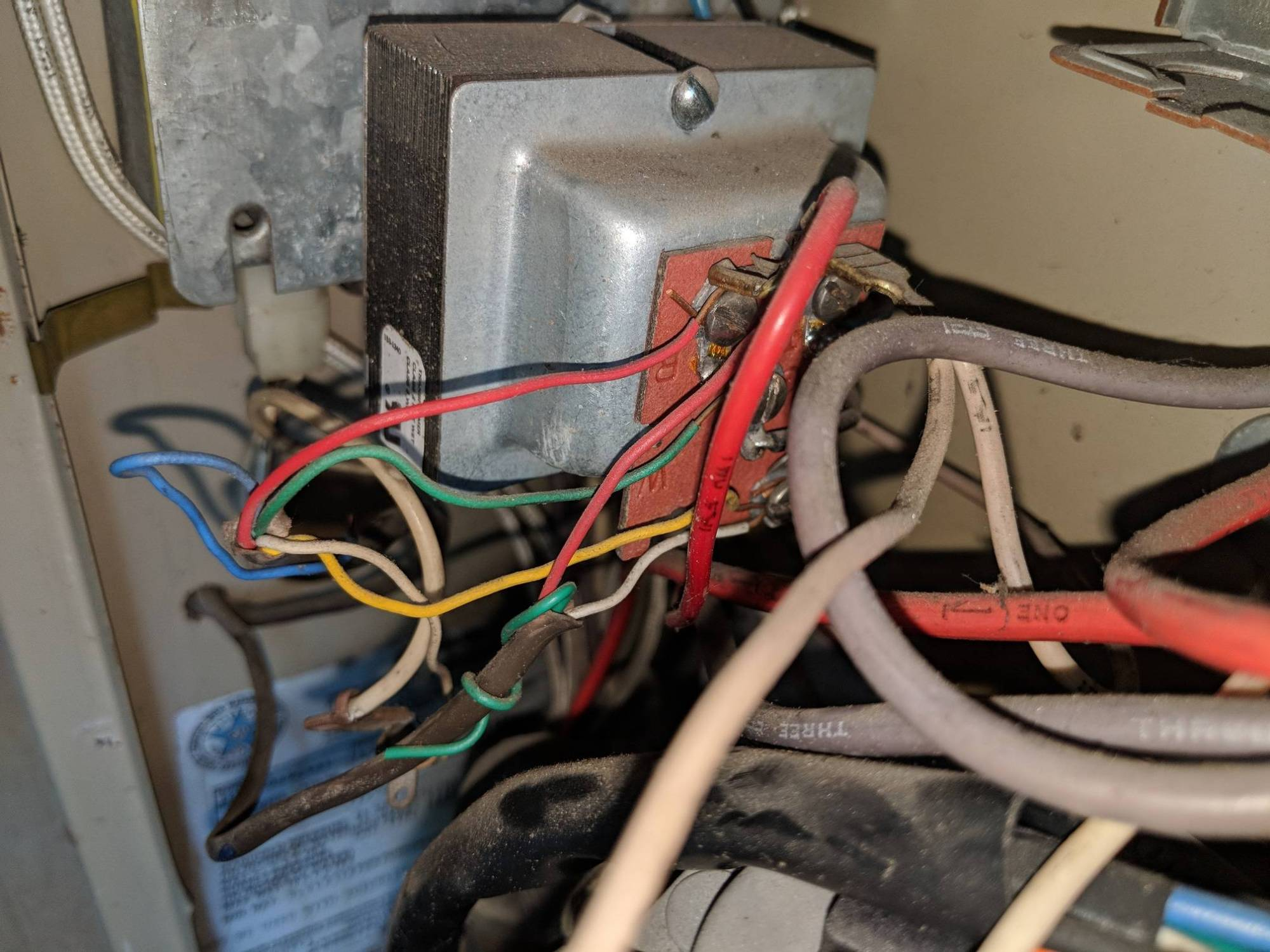 hight resolution of the wire bundle with the blue wire is the one coming from the thermostat and the wire bundle with the wrapped unused green is coming from the ac unit i