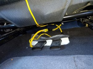 chevrolet  Two cable connectors under each car seat  what are they for?  Motor Vehicle
