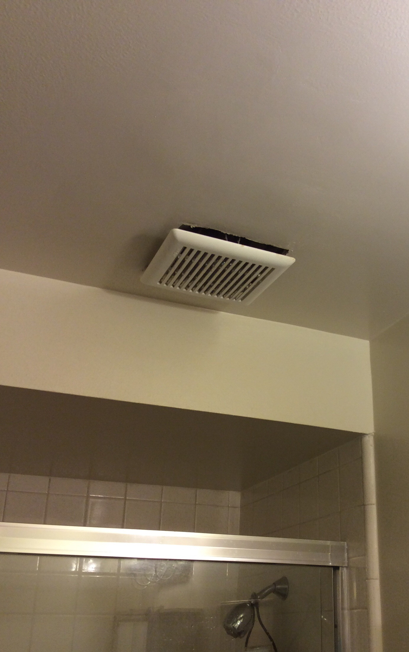 bathroom  Is it normal for an exhaust fan cover to hang