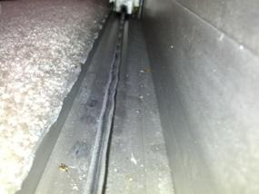 warped sliding glass door track