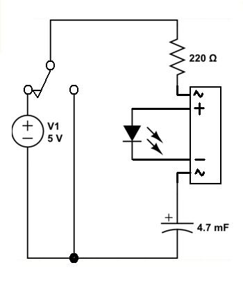 Howto discharge a capacitor through an LED by removing the