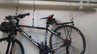 storage - Best way to hang a bicycle from a ceiling pipe ...