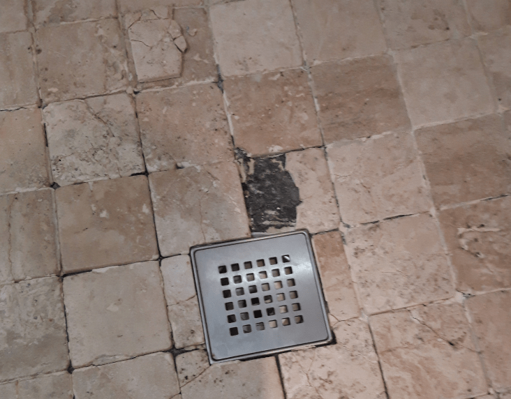 removing shower tiles from waterproof