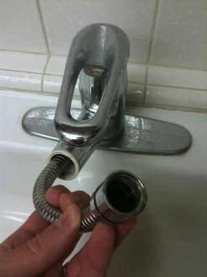 kitchen faucet sprayer leak
