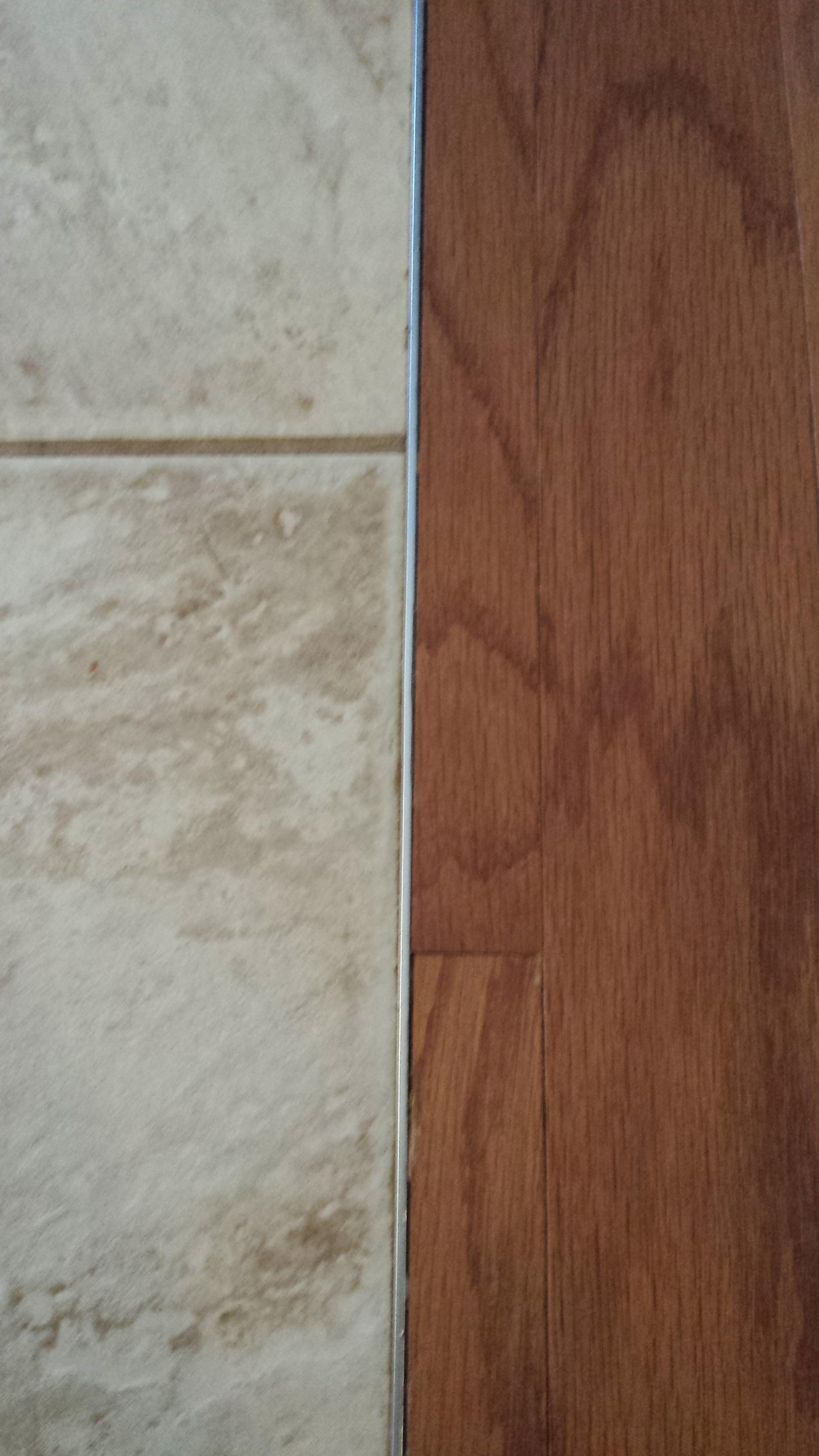 can i install laminate next to tile