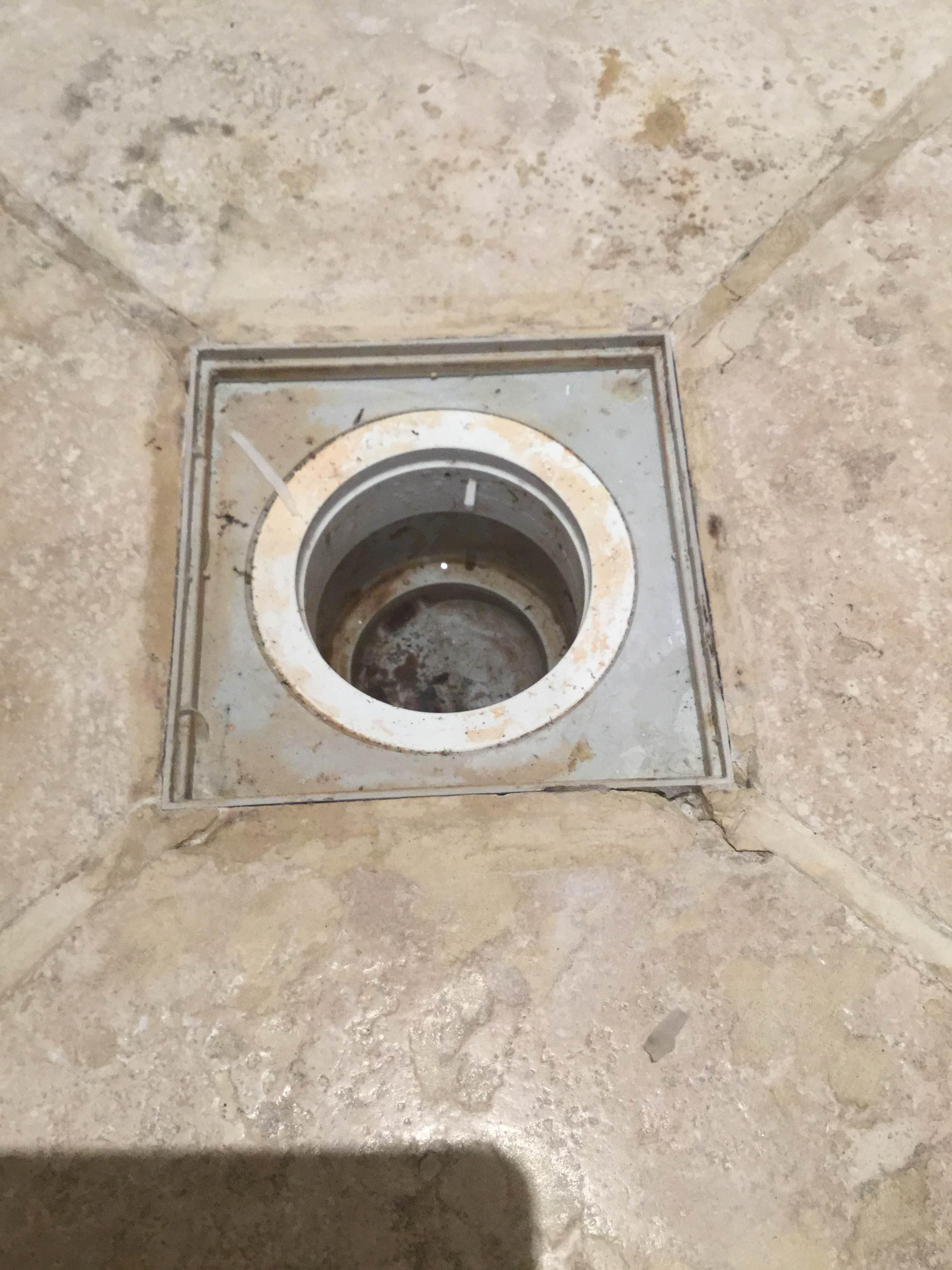 shower  How can I repair cracked stones around a drain in