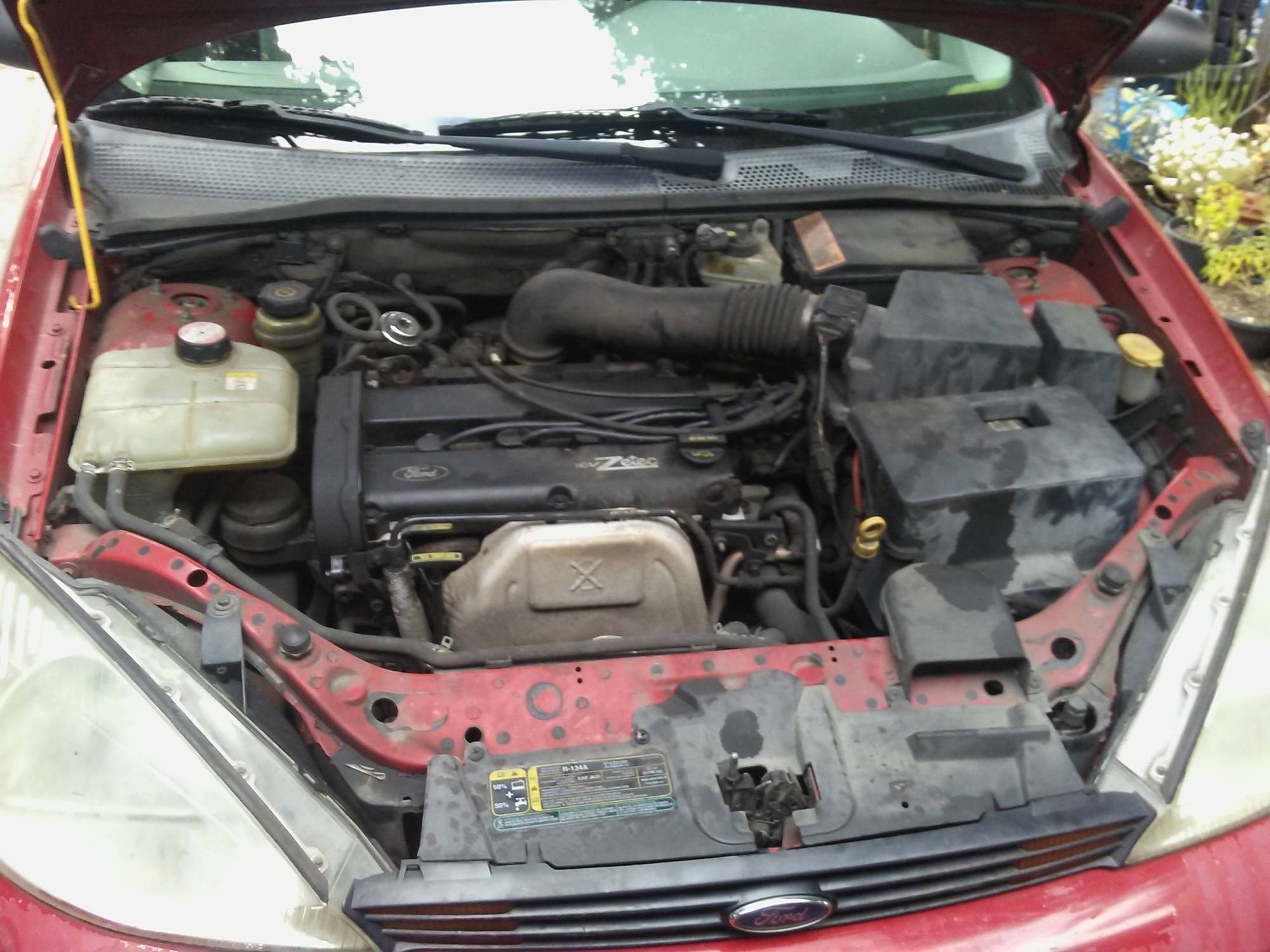 hight resolution of photo of dirty ford focus engine bay