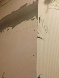 How do I transition between tile and drywall in a tub