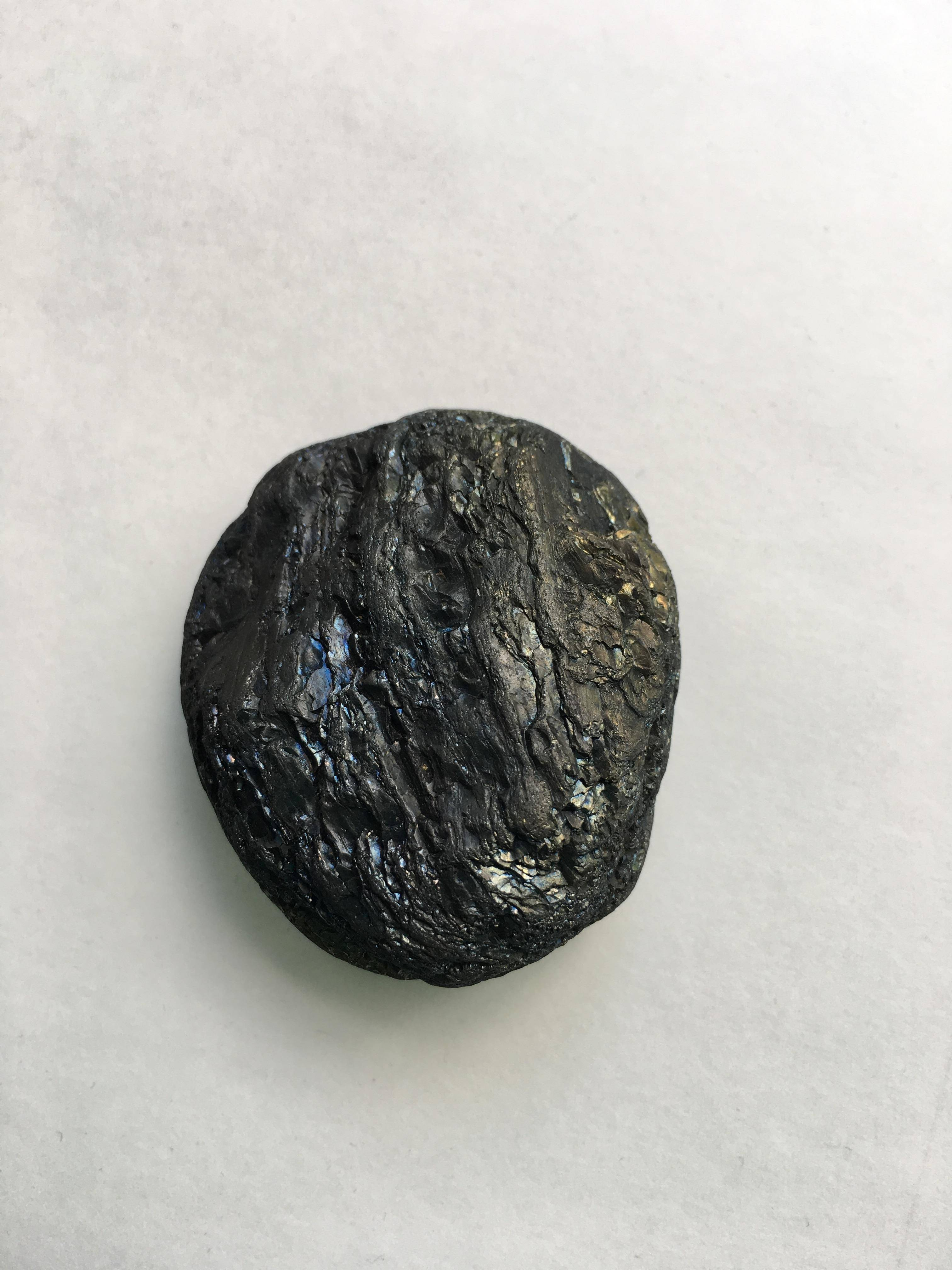Rock identification  very hard brownish black with gold