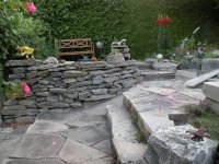 Raised beds border - made of a dry stone wall - Gardening ...