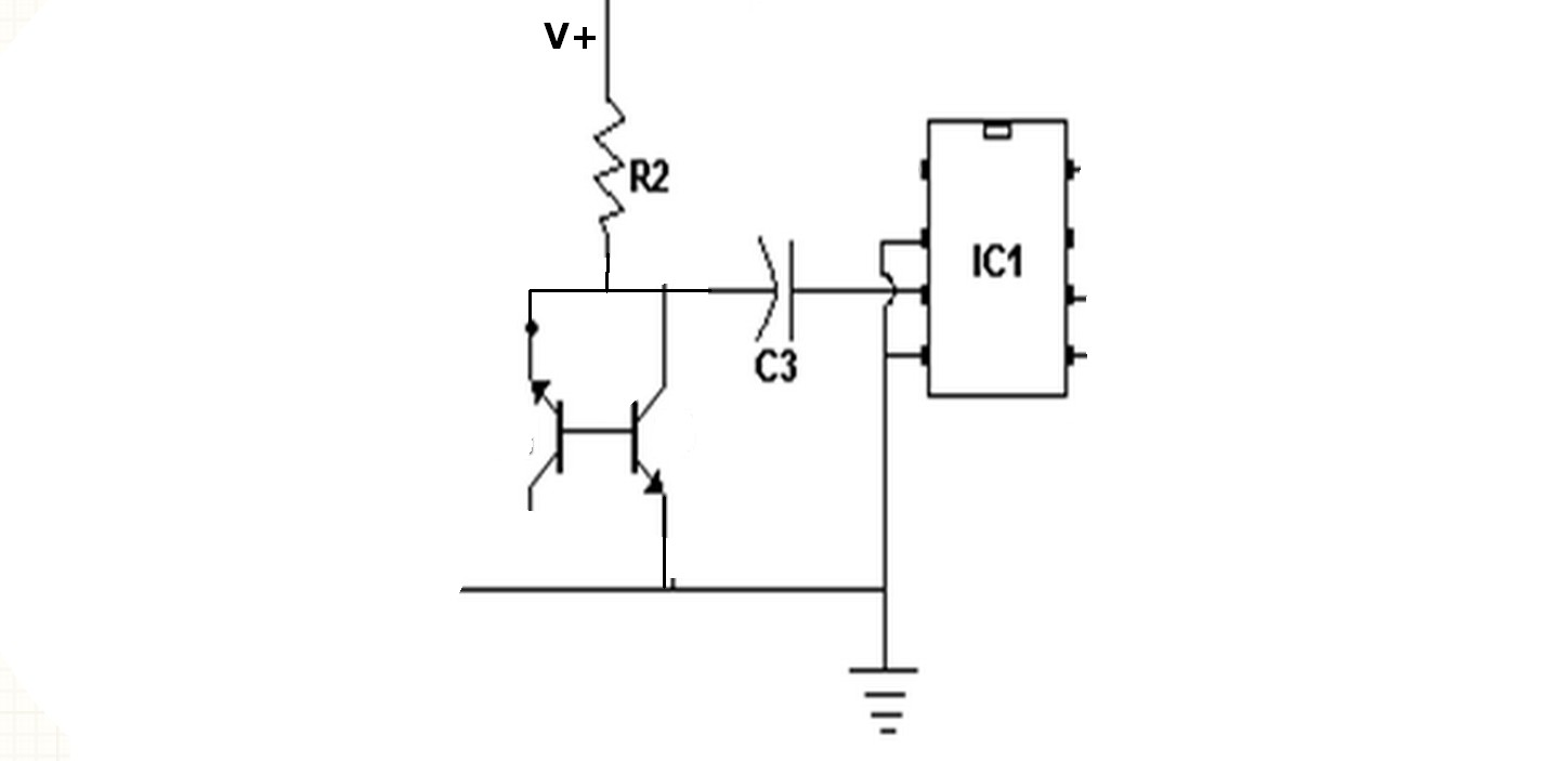 Positive of polarized capacitor connected to ground