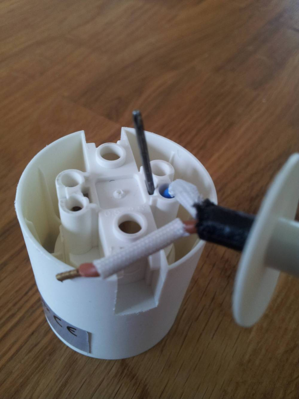 medium resolution of wiring how can i remove the wires from this lamp holder home wiring a 3 way bulb socket wiring a light socket