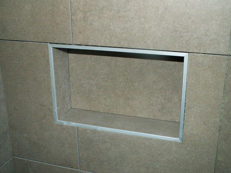 mitered tile edge trim around niche in