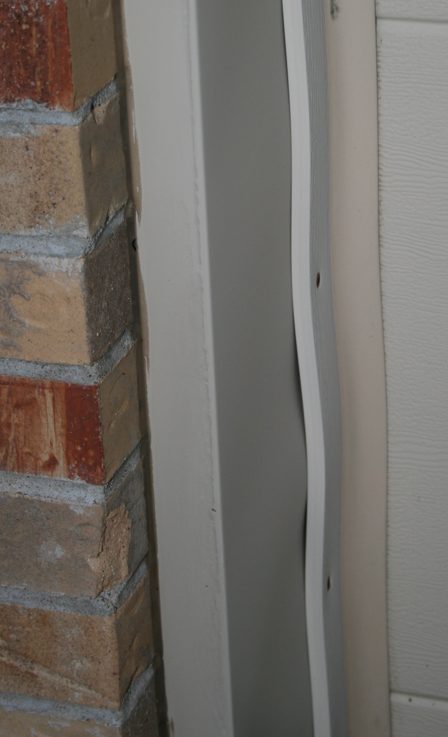 How can I repair this garage door trim and weather stripping  Home Improvement Stack Exchange
