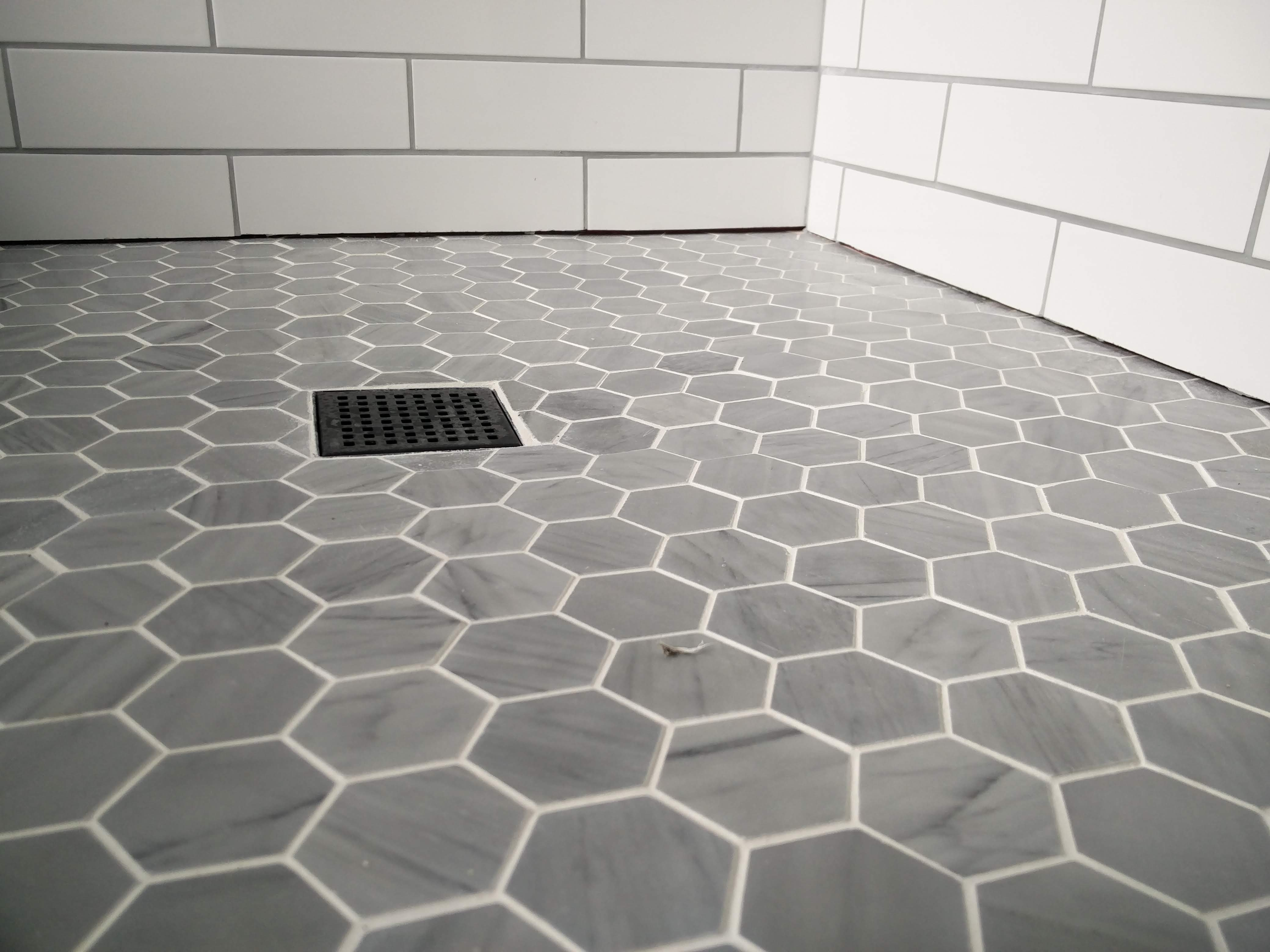should the edge of a tiled shower wall
