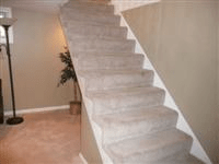 stairs - How should I add a rail on a carpeted stairway ...