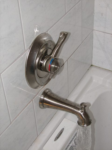 plumbing  Why does my shower head drip when the tub
