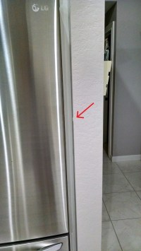 How can I prevent my refrigerator door from hitting the ...